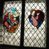 Two stained glasses elements with knight in armor