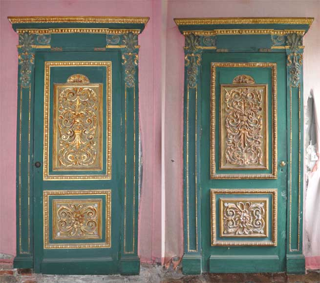 Pair of green doors with a gilded wooden decoration-0