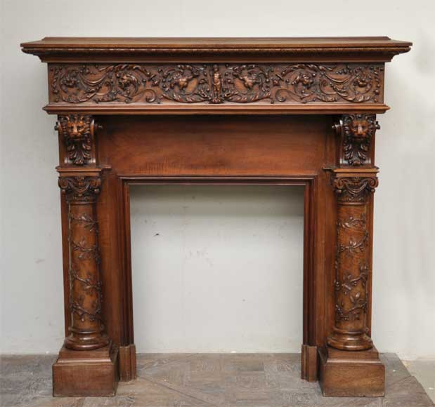 Antique walnut fireplace with grotesques and lions heads decoration-0