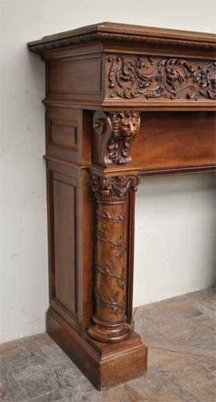 Antique walnut fireplace with grotesques and lions heads decoration-2