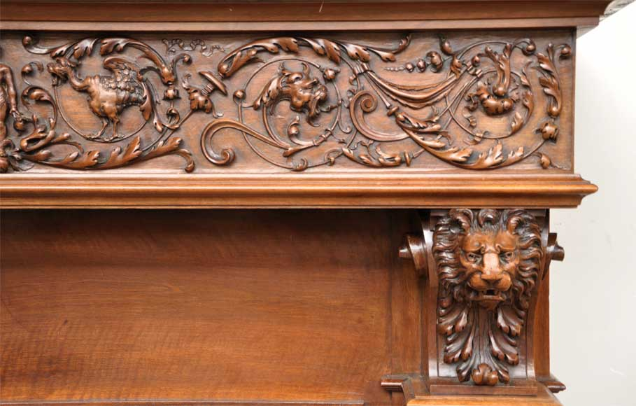 Antique walnut fireplace with grotesques and lions heads decoration-7