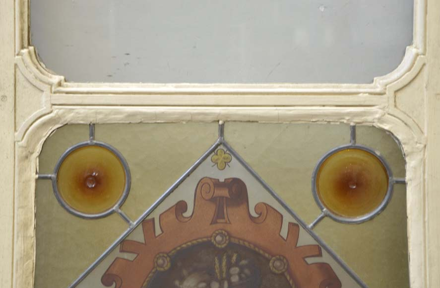 Double door with stained glass windows,  man and woman's profile in medallion-2