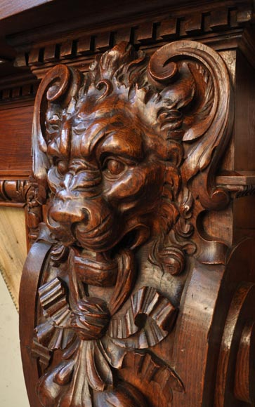 Large antique fireplace with lions heads carved out of oak wood