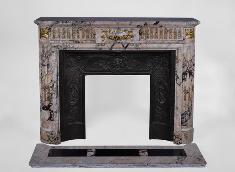 Beautiful antique Louis XVI style fireplace in Breccia marble with fluted rounded corners and gilt bronze ornaments - Reference 2317