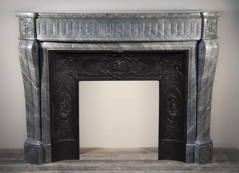 Antique Louis XVI style fireplace with curved jambs made out of Blue Turquin marble-0