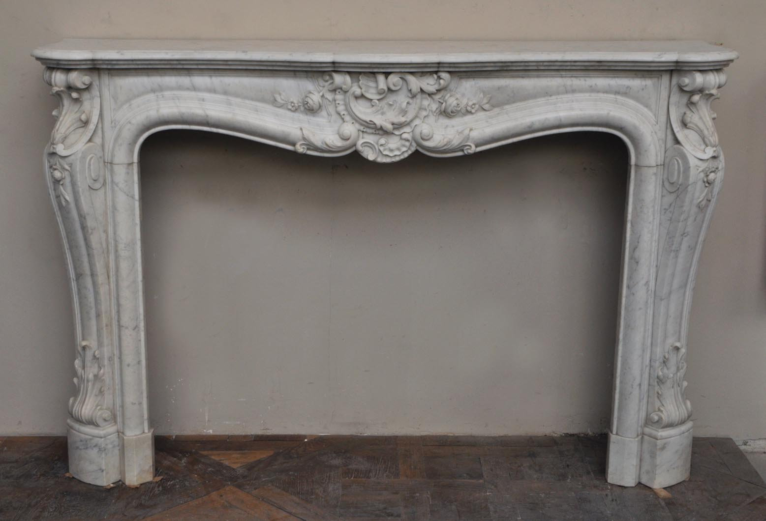 Large antique Louis XV style fireplace with roses decoration in Carrara marble - Reference 2401