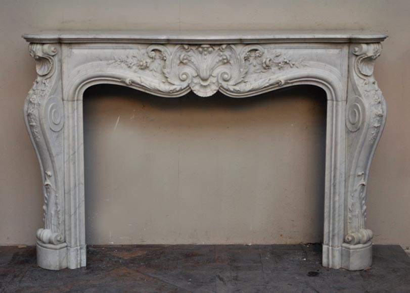 Exceptional antique Louis XV style fireplace with flowers decoration in Carrara marble - Reference 2466
