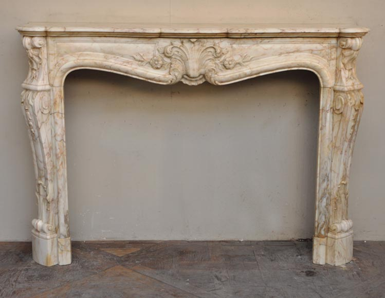 Antique Louis XV style fireplace in a veined marble - Reference 2475
