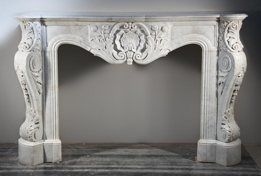 Opulent Louis XV style fireplace made out of Carrara marble - Reference 2581