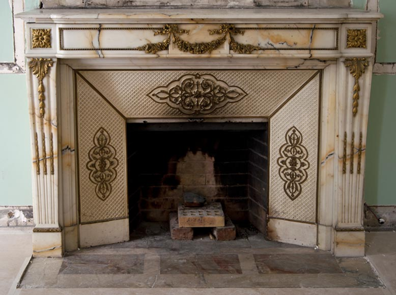 Very beautiful antique Louis XVI style fireplace made out of Panazeau marble with gilded bronze ornaments-0