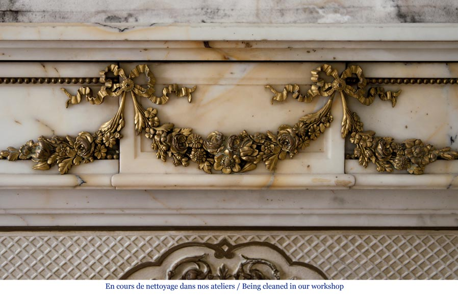 Very beautiful antique Louis XVI style fireplace made out of Panazeau marble with gilded bronze ornaments-1