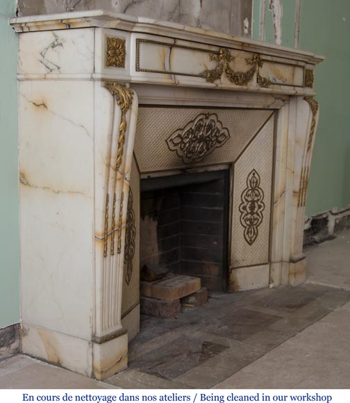 Very beautiful antique Louis XVI style fireplace made out of Panazeau marble with gilded bronze ornaments-5