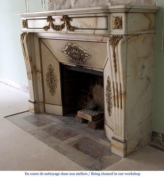 Very beautiful antique Louis XVI style fireplace made out of Panazeau marble with gilded bronze ornaments-11