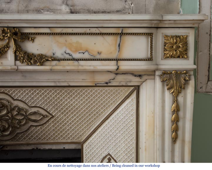 Very beautiful antique Louis XVI style fireplace made out of Panazeau marble with gilded bronze ornaments-12