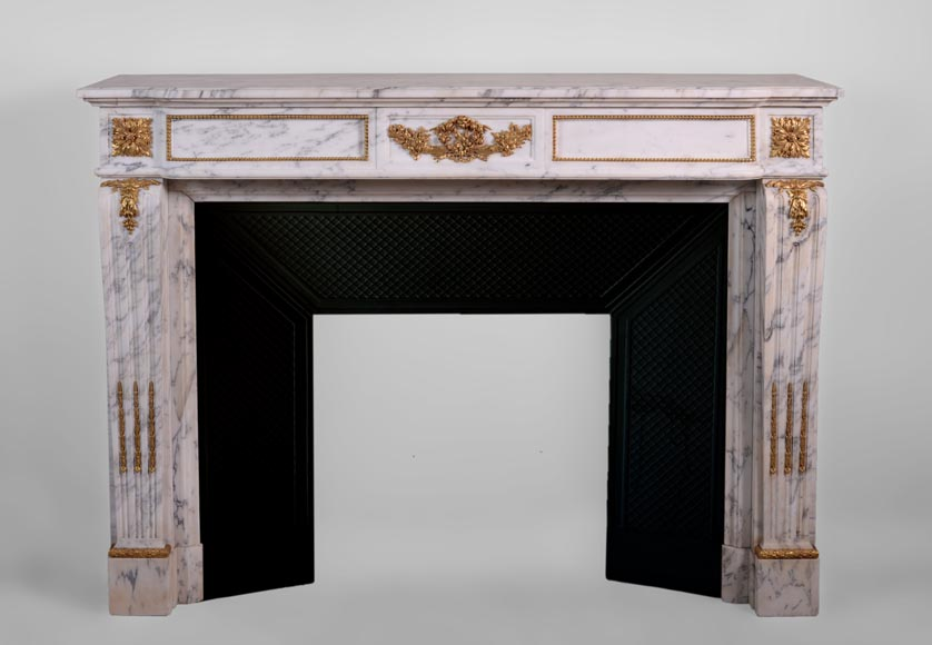 Beautiful antique Louis XVI style fireplace made out of Grey Panazeau with gilded bronze ornaments-0