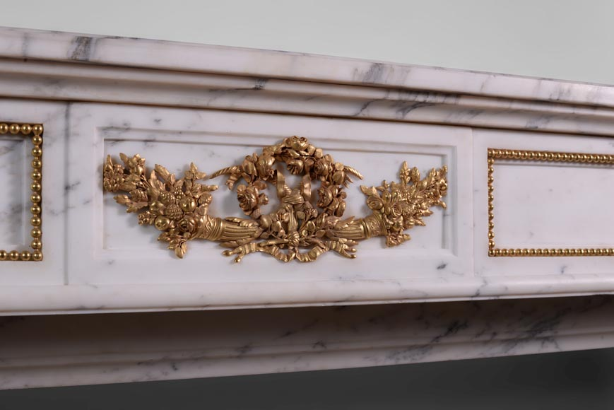 Beautiful antique Louis XVI style fireplace made out of Grey Panazeau with gilded bronze ornaments-1
