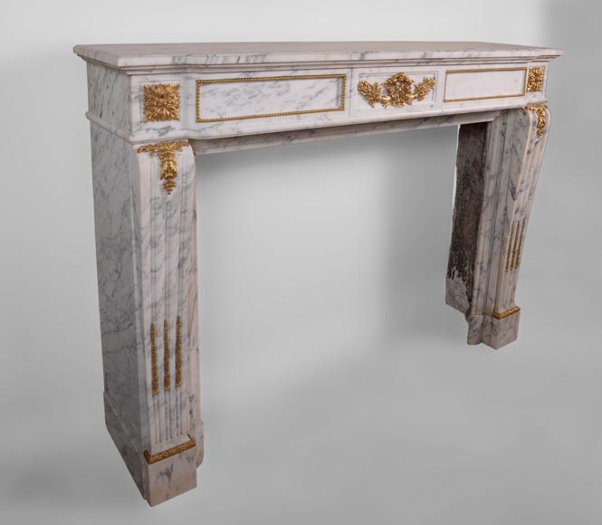 Beautiful antique Louis XVI style fireplace made out of Grey Panazeau with gilded bronze ornaments-2
