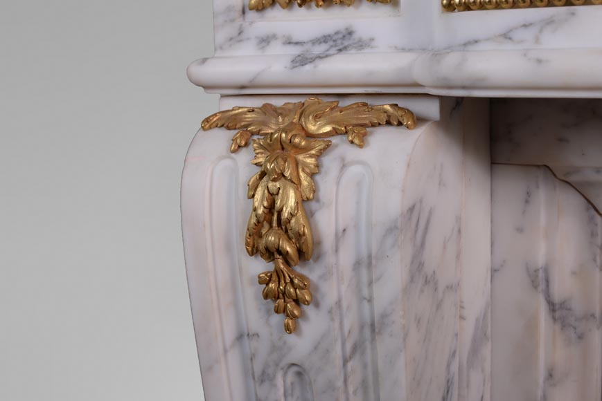 Beautiful antique Louis XVI style fireplace made out of Grey Panazeau with gilded bronze ornaments-4