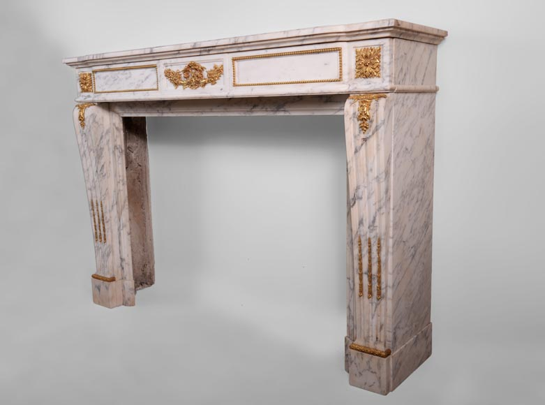 Beautiful antique Louis XVI style fireplace made out of Grey Panazeau with gilded bronze ornaments-7
