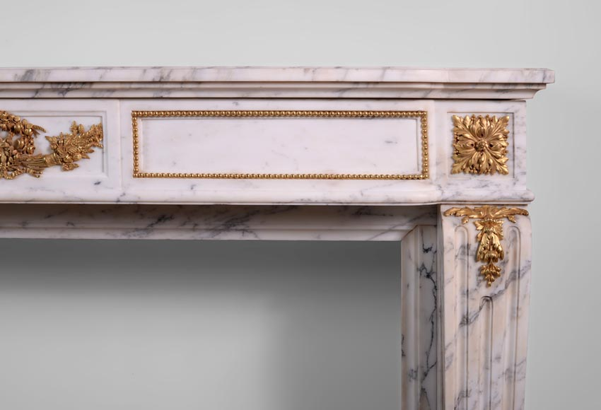 Beautiful antique Louis XVI style fireplace made out of Grey Panazeau with gilded bronze ornaments-8