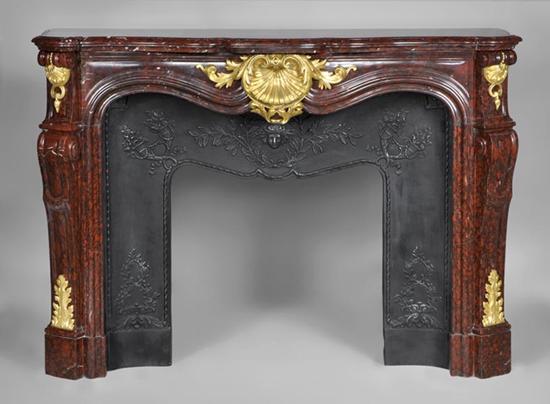 Very beautiful antique Louis XV style fireplace made out of Red Griotte marble with gilded bronze ornaments - Reference 2646
