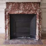 Antique Louis XIV style fireplace with acroterion made out of Red from the Languedoc marble