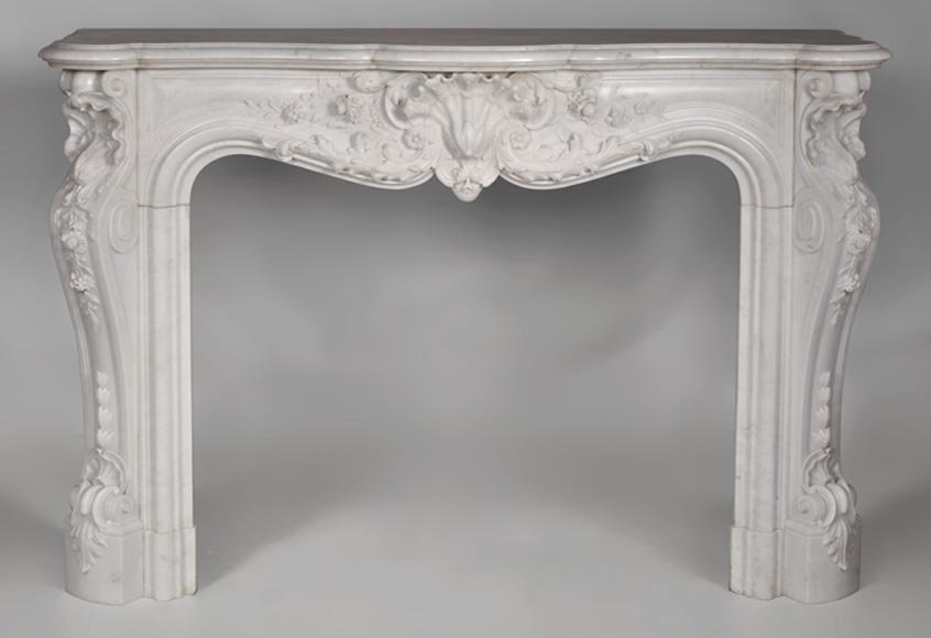 Exceptional antique opulent Louis XV style fireplace with carved flowers made out of Carrara marble - Reference 2745