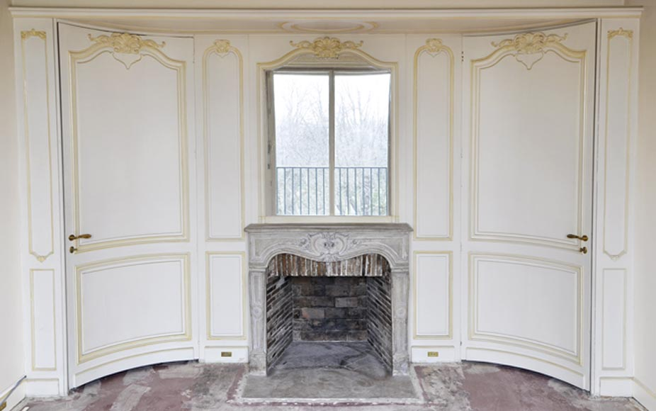 Beautiful Louis XV style paneled room with 18th century stone fireplace-0