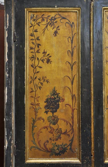 Double door with frame with putti and flowers decor on gold painting background-1