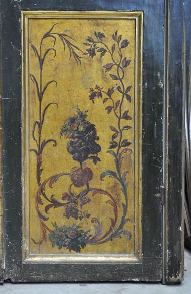 Double door with frame with putti and flowers decor on gold painting background-11