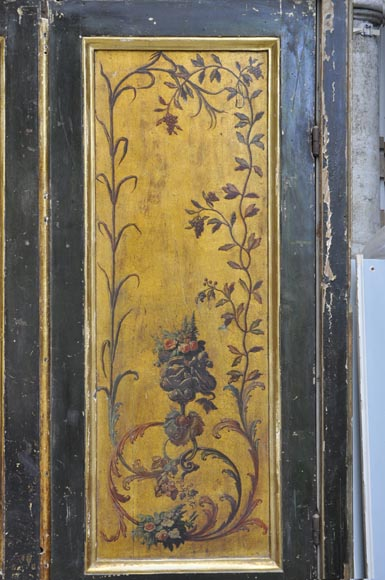 Double door with frame with putti and flowers decor on gold painting background-12