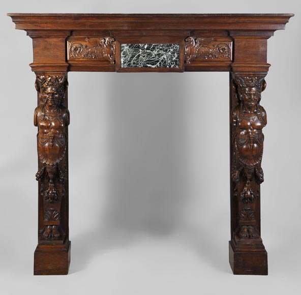 Beautiful antique Neo-Renaissance style carved walnut fireplace with Satyrs decor made after the monumental fireplace coming from the Chateau of Villeroy and exhibited at the Louvre Museum - Reference 2825