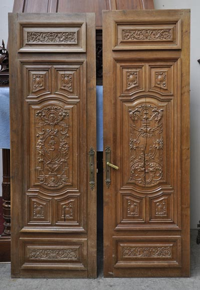 False pair of antique  carved oak doors from the 19th century-0