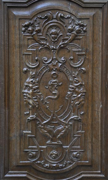 False pair of antique  carved oak doors from the 19th century-1