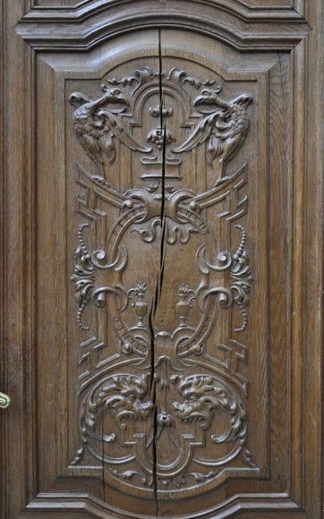 False pair of antique  carved oak doors from the 19th century-4