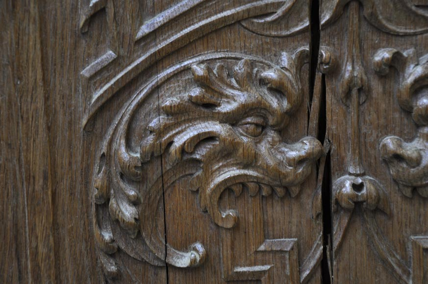 False pair of antique  carved oak doors from the 19th century-7