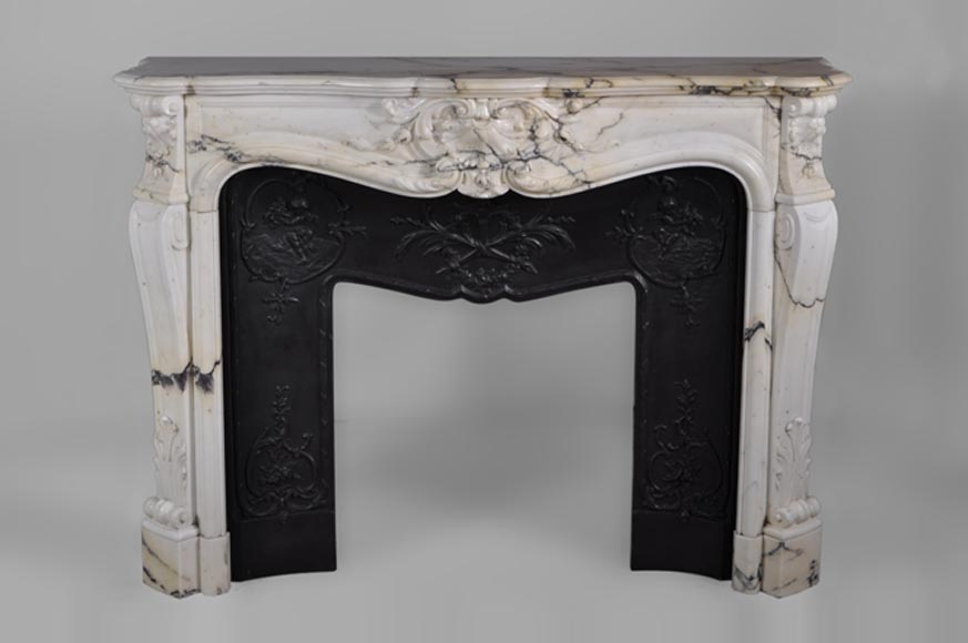 Beautiful antique Louis XV style fireplace carved in a Grey Panazeau marble - Reference 2878