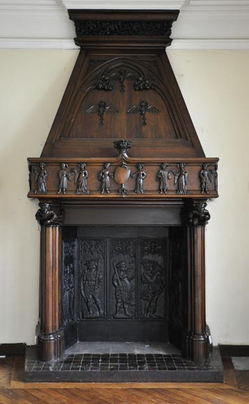 Monumental antique Neo-Gothic style fireplace with hood made out of carved walnut and courtly scenes-0