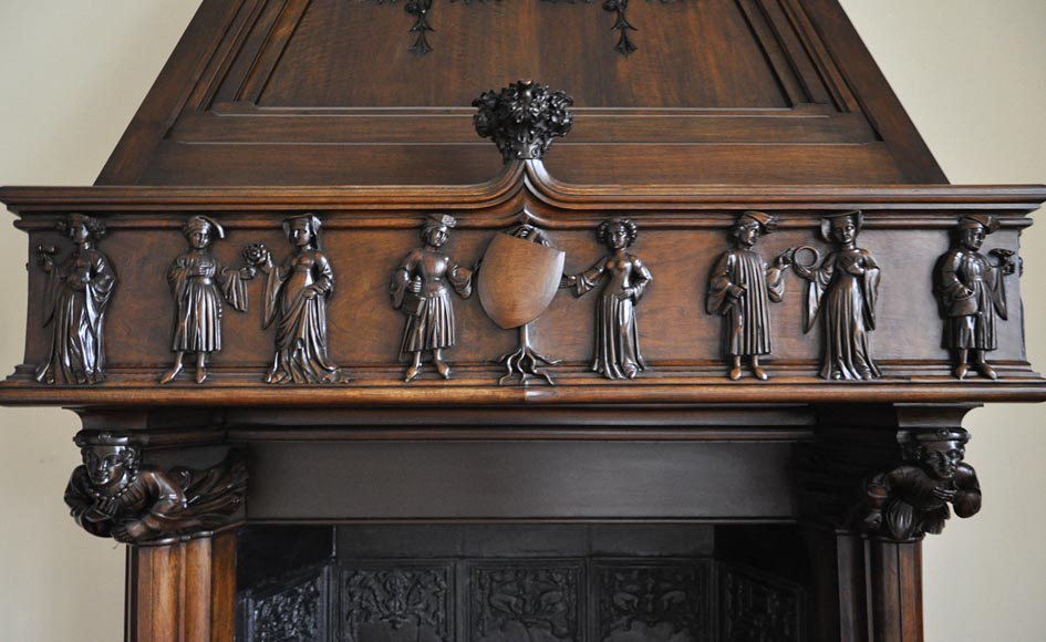 Monumental antique Neo-Gothic style fireplace with hood made out of carved walnut and courtly scenes-1