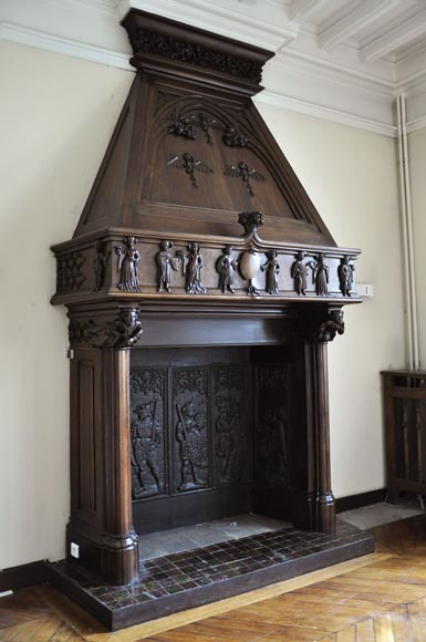 Monumental antique Neo-Gothic style fireplace with hood made out of carved walnut and courtly scenes-2
