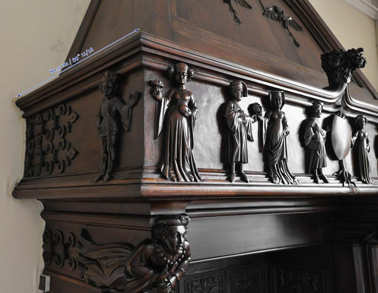 Monumental antique Neo-Gothic style fireplace with hood made out of carved walnut and courtly scenes-14
