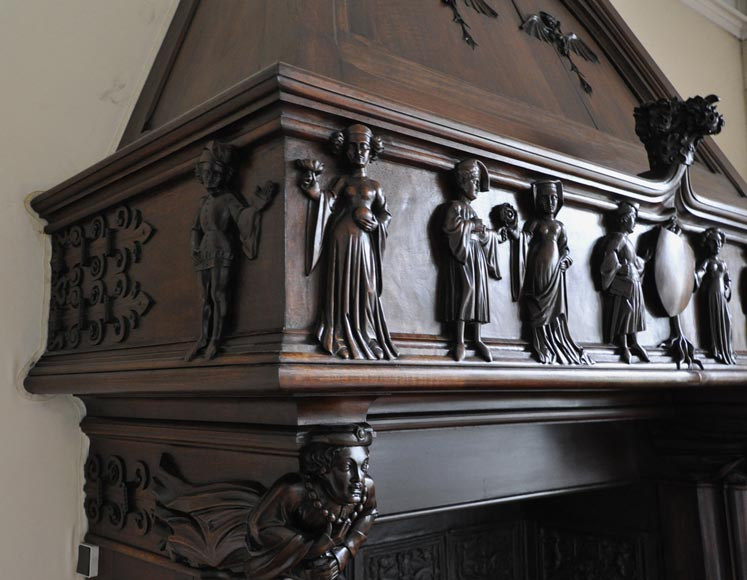 Monumental antique Neo-Gothic style fireplace with hood made out of carved walnut and courtly scenes-3