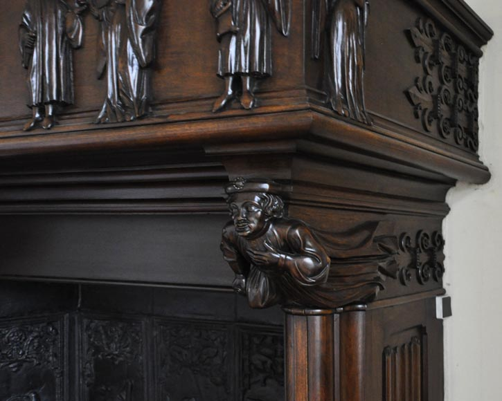 Monumental antique Neo-Gothic style fireplace with hood made out of carved walnut and courtly scenes-6