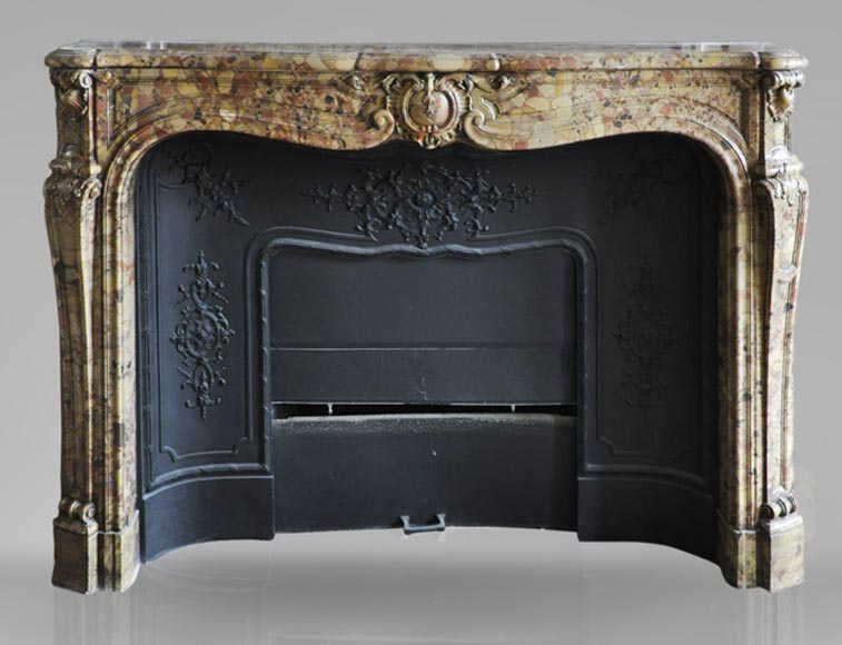 Beautiful antique Louis XV period fireplace in Breche d'Alep marble decorated with a cartouche and a cast iron insert-0