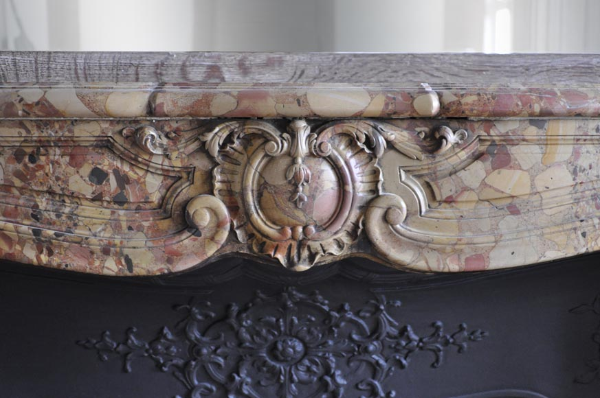 Beautiful antique Louis XV period fireplace in Breche d'Alep marble decorated with a cartouche and a cast iron insert-1