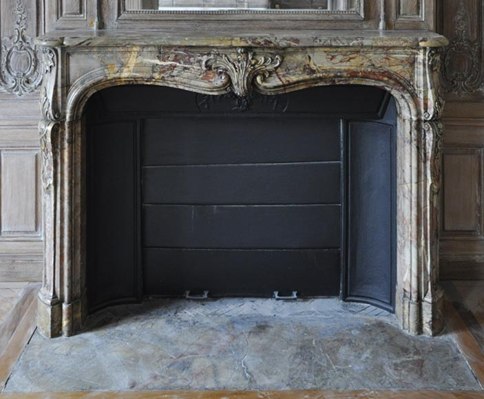 Beautiful antique Louis XV period fireplace in Sarrancolin Ilhet marble decorated with foliated cartouche - Reference 2982