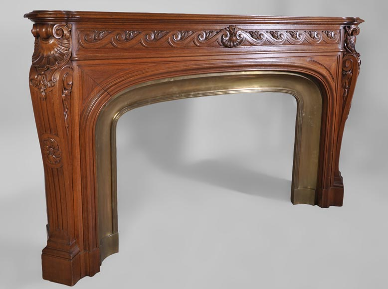 Large antique Napoléon III style fireplace made out of carved oak with brass insert-3