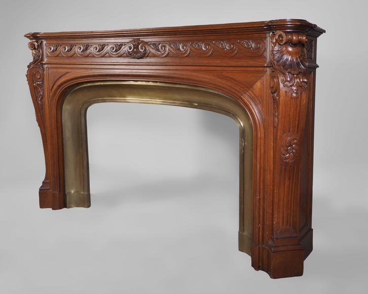 Large antique Napoléon III style fireplace made out of carved oak with brass insert-7
