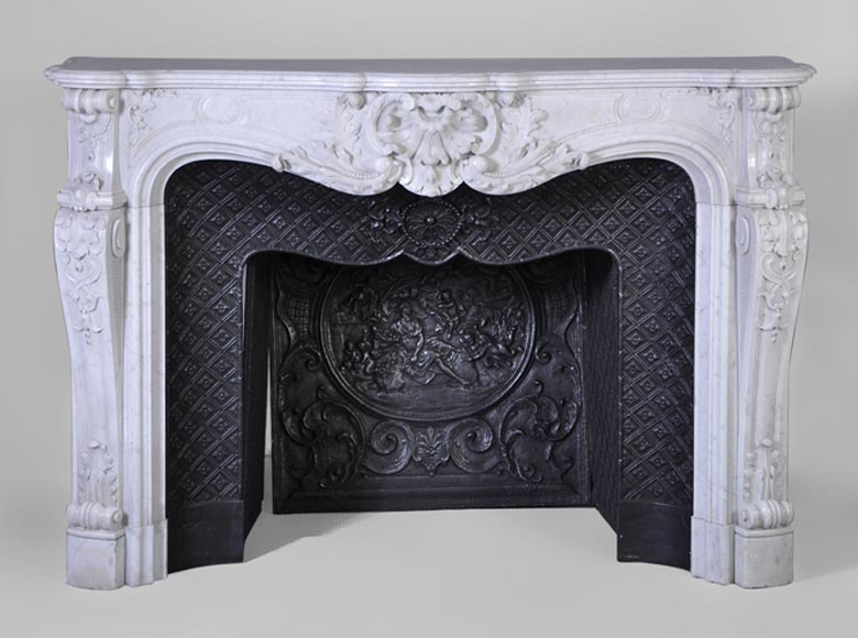 Very beautiful antique Louis XV style fireplace with opulent decor, in white Carrara marble with its complete cast iron insert - Reference 3053