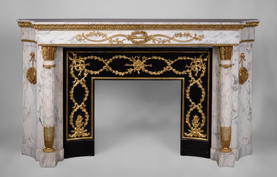 Very beautiful antique Louis XVI style fireplace in Arabescato marble with quiver-shaped columns, gilt bronze ornaments and curved sides after the model from the Chateau of Fontainebleau-0